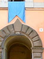 a blue banner honours those bearing the effigy of the Virgin Mary